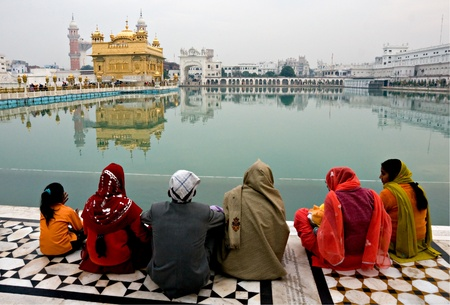 People meditating at the golden temple. photo