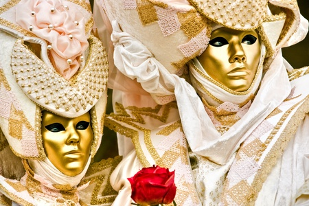 carnevale: Golden masks with a roed rose, Carnival, Venice 2008.