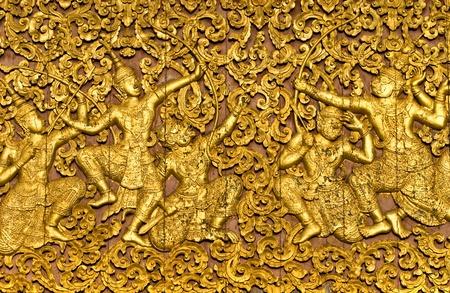 gautama: The ramayana epic carved on a wood door, Luang Prabang, Laos. Stock Photo