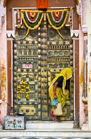 Woman and door of a Temple in Orcha, Madhya Pradesh, india. photo