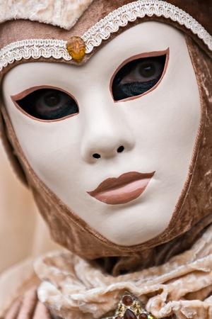 Brown elegant mask in Venice, Italy. photo