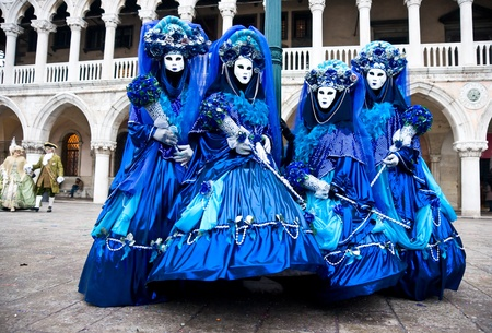 Four Blue mask in Venice, Italy. photo