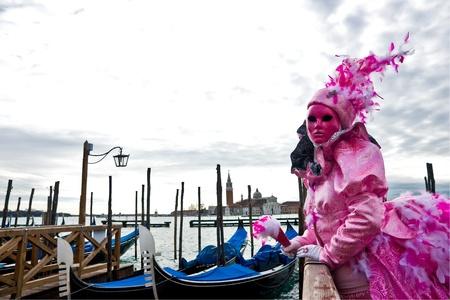 Pink Mask, venice carnival, Italy. photo