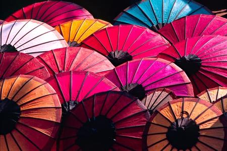 parasols: Umbrella at a tipical market, Luang Prabang,  Laos. Stock Photo