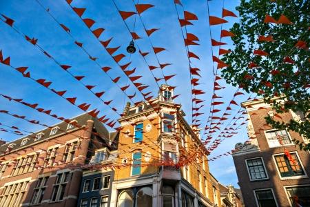 gabled house: Orange Flag on the street, Amsterdam  Holland