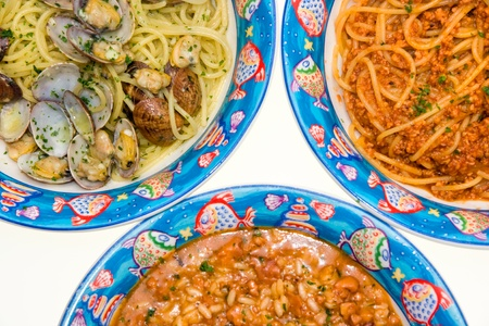 Tris of Italian Pasta and Rice. ( Spaghetti with Clams, Spaghetti with mix seafood, Rice with Squid.) Stock Photo - 9076171