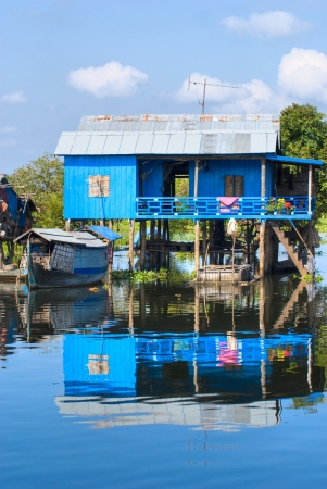 houseboat: Typical House on the Tonle sap lake, with a small houseboat  Cambodia