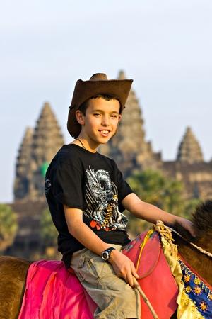Children visiting  Angkor Wat Temple at sunset, Siem reap, Cambodia