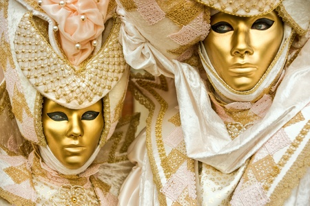 Two golden masks in Venice, Italy. photo