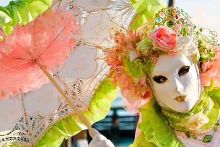 mardigras: Beautiful mask with umbrella in Venice, Italy