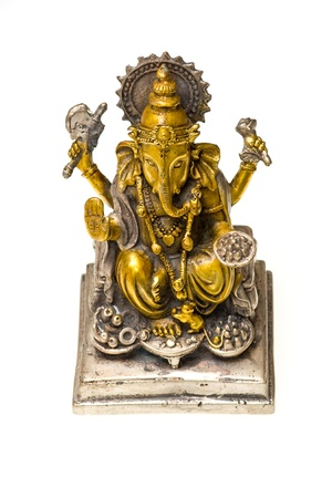 Bronze statue of Ganesh, Hindu god,  painted in gold and silver. photo