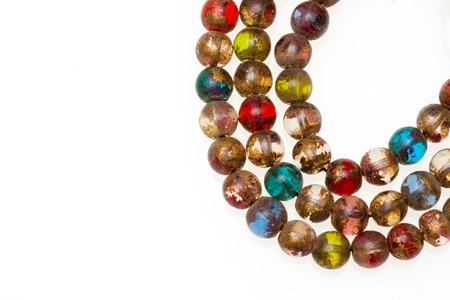 Close-up picture of a Mala made of colored glass. Isolated on white. Stock Photo - 9075677