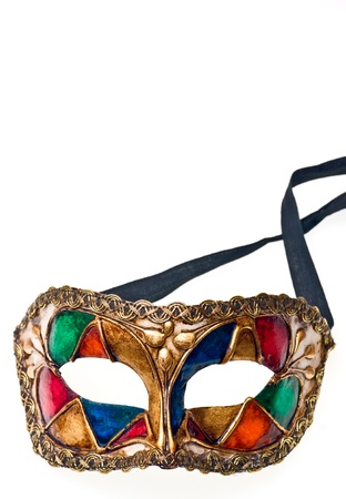 Close-up of colored venetisn mask. Isolated on white. photo