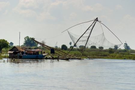 Fishing net and houseboat  Tonle Sap Lake,   Cambodia  Stock Photo - 17670034