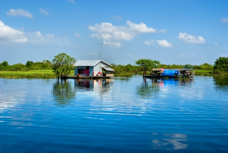 Floating House and  Houseboat on the Tonle Sap lake, between Battambang and Siem reap  Cambodia   Stock Photo