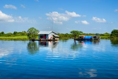mekong: Floating House and  Houseboat on the Tonle Sap lake, between Battambang and Siem reap  Cambodia   Stock Photo
