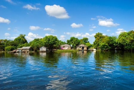 Floating House and  Houseboat on the Tonle Sap lake, between Battambang and Siem reap. Cambodia.  photo