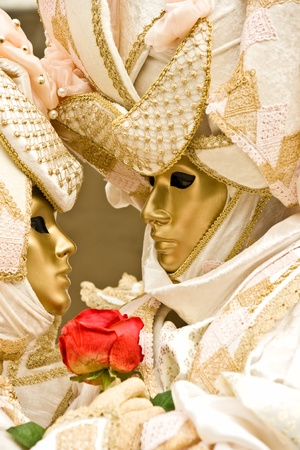 Two golden mask in Venice, Italy. photo