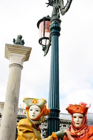 Two  masks in Venice, Italy  photo
