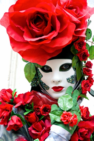 masque: Beautiful Red rose mask in Venice Carnival, Italy. Stock Photo
