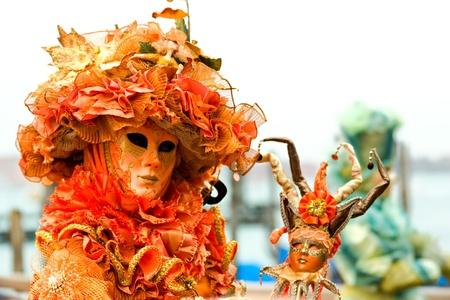 Orange mask in Venice, Italy. photo