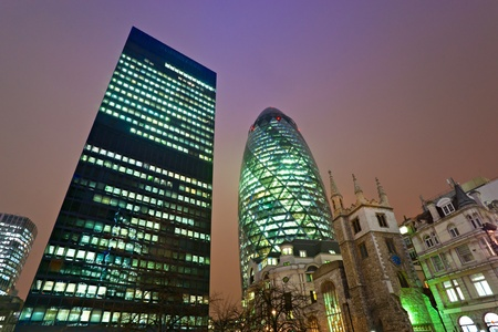 Evening time shot of Londons famous skyscrapers including the Gherkin ant the Aviva, London, England. photo