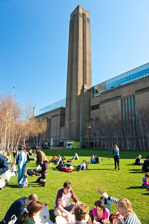 illuminating: LONDON - MARCH 19   Peoples relaxing outside the Tate Modern Gallery during the exhibition of gabriel orozco   March 19, 2011 in London, UK Editorial