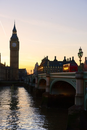 The Big Ben, the House of Parliament and the Westminster Bridge at night, London, UK. photo