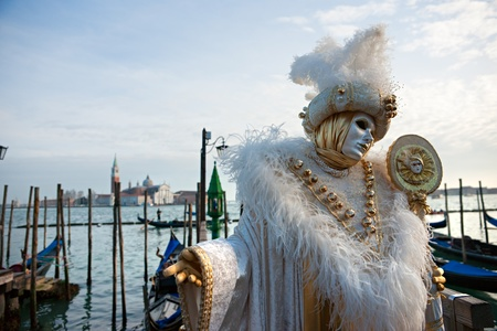 VENICE - MARCH 05: Participant in The Carnival of Venice, an annual festival that starts around two weeks before Ash Wednesday and ends on Mardi Gras on March 05 2011 in Venice, Italy. photo