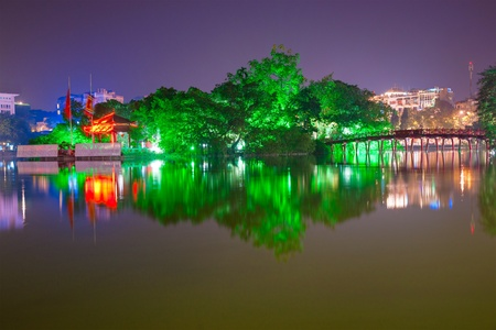 ha: Night shot of Red Bridge in Hoan Kiem Lake, Ha Noi, Vietnam.