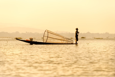 Silhouette of Fisherman in inle lake, Myanmar. photo