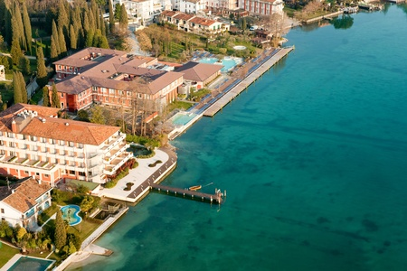 garda: Aerial view of the Scaliger Castle  in Sirmione by lake Garda, Italy Editorial
