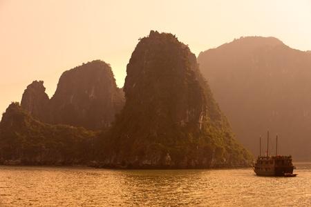 vietnam flag: Halong Bay, Vietnam. Unesco World Heritage Site. Most popular place in Vietnam. Stock Photo