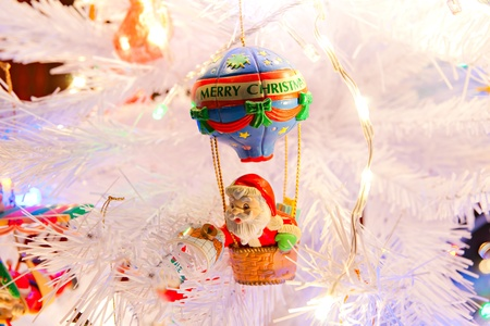 Christmas decorations in a white tree. photo