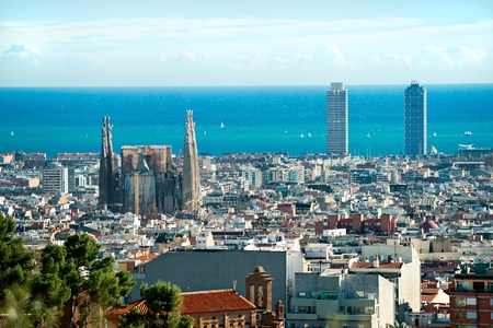 catalunia: View of Sagrada Familia and port from Park Guell. Barcelona, Spain.