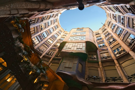 BARCELONA, SPAIN - DECEMBER 18: Casa Mila, or La Pedrera, on December 18, 2011 in Barcelona, Spain. This famous building was designed by Antoni Gaudi