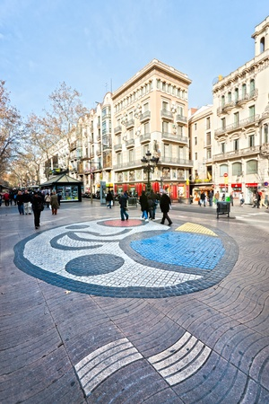 BARCELONA, SPAIN - DECEMBER 20: La Rambla on December 20, 2011 in Barcelona, Spain. Thousands of people walk daily by this popular pedestrian area 1.2 kilometer-long photo