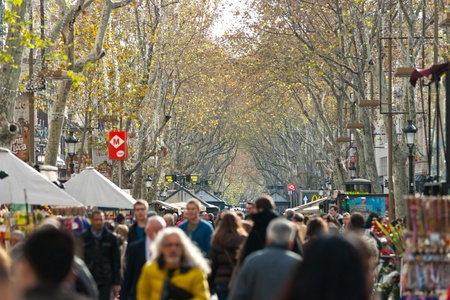 BARCELONA, SPAIN - DECEMBER 20: La Rambla on December 20, 2011 in Barcelona, Spain. Thousands of people walk daily by this popular pedestrian area 1.2 kilometer-long