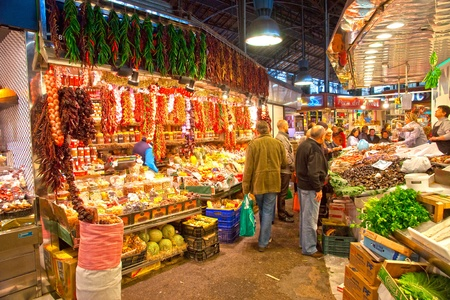 BARCELONA, SPAIN : Tourists shop in famous La Boqueria market