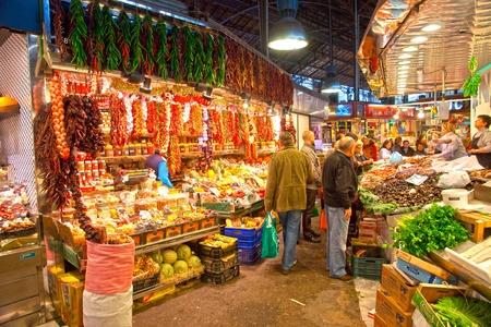 BARCELONA, SPAIN : Tourists shop in famous La Boqueria market  Stock Photo - 12412282