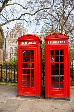 Two red telephone box outside the natural history museum. London, UK. photo