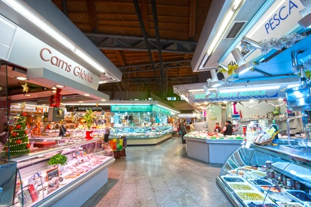 BARCELONA, SPAIN - DECEMBER 20: Tourists shop in famous La Boqueria market on December 20, 2011 in Barcelona, Spain. One of the oldest markets in Europe that still exist. Established 1217. Stock Photo - 12877739