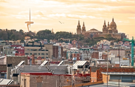 guell: Barcelona at sunset, with the Telecommunication tower and the Mnac, the National museum of art of Catalunya. Spain.