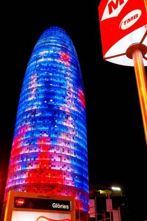 BARCELONA, SPAIN - DECEMBER 19: Torre Agbar on Technological District on December 19, 2011 in Barcelona, Spain. This 38-storey tower was designed by the famous architect Jean Nouvel. Stock Photo - 12877646