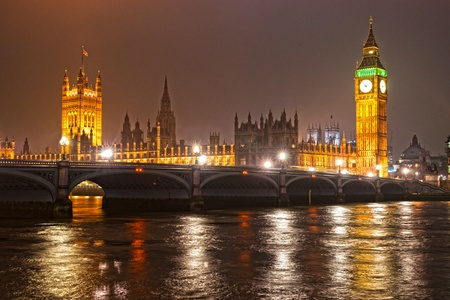 london eye: The Big Ben, the House of Parliament and the Westminster Bridge at night, London, UK. Stock Photo