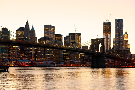 Sunset on Brooklyn bridge and Manhattan, New York City. USA. photo