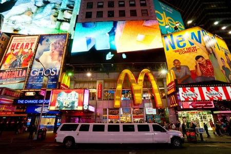 NEW YORK CITY -MARCH 25: Times Square, featured with Broadway Theaters and animated LED signs, is a symbol of New York City and the United States, March 25, 2012 in Manhattan, New York City. USA. Stock Photo - 13315448