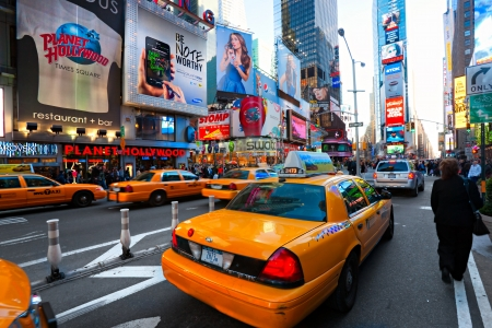 NEW YORK CITY -MARCH 25: Times Square, featured with Broadway Theaters and animated LED signs, is a symbol of New York City and the United States, March 25, 2012 in Manhattan, New York City. USA. Stock Photo - 13877319