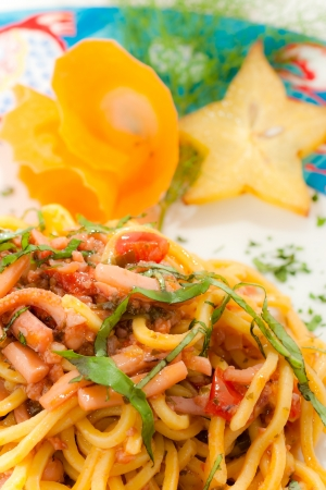 Spaghetti with seafoood in a decorated plate  photo