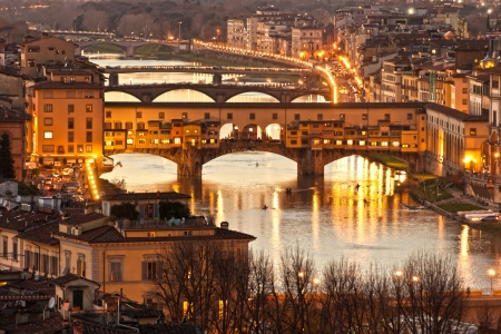 Panoramic view of Ponte Vecchio after sunset, Florence. Tuscany. Stock Photo